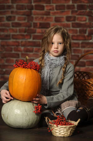 Autumn portrait of a girl with a pumpkin photo