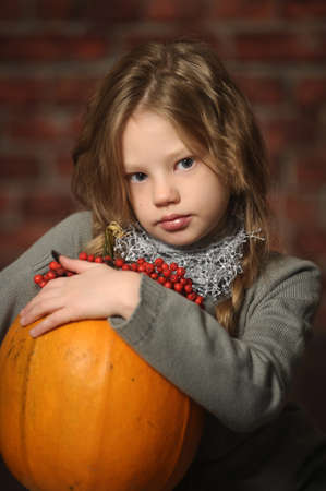 Young girl with a yellow pumpkin Stock Photo - 18207237