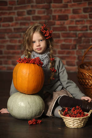 Young girl with a yellow pumpkin Stock Photo - 18207241