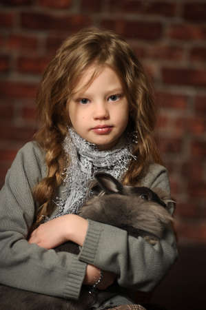 cary: portrait of a girl with a rabbit in his hands Stock Photo