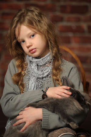 portrait of a girl with a rabbit in his hands Stock Photo - 18161687