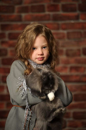 joyless: portrait of a girl with a rabbit in his hands Stock Photo
