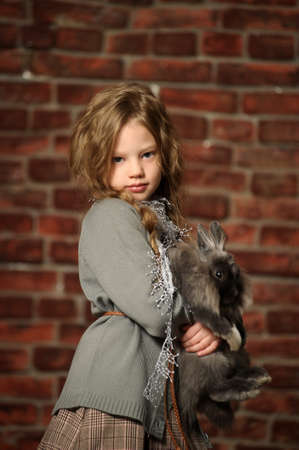 portrait of a girl with a rabbit in his hands photo