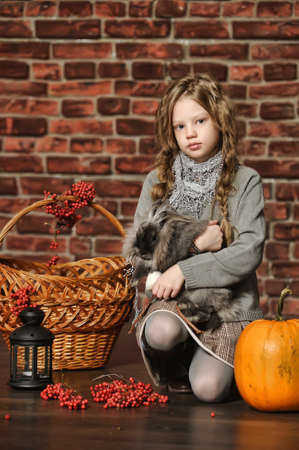 girl with a rabbit in his hands Stock Photo - 18161791