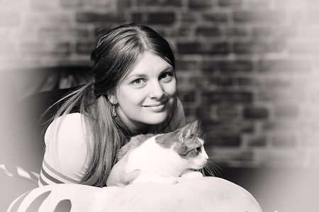 portrait of happy young woman with a cat in hands photo
