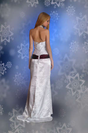 blonde girl in a white dress studio snowflakes photo
