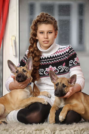 half breed: girl with two puppies