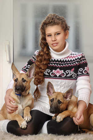 girl with two puppies Stock Photo - 17917740