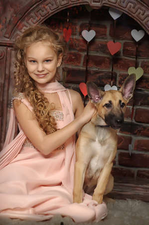 well dressed girl: girl with a puppy Stock Photo