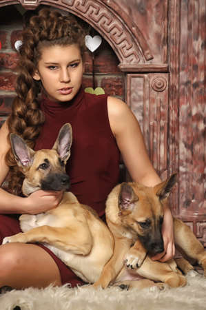 Yoing woman holding two puppies photo
