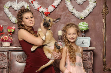 two sisters with a puppy Stock Photo - 17935849