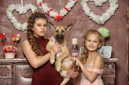 two sisters with a puppy Stock Photo - 17935854