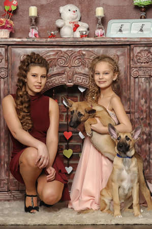 Two girls with puppies photo