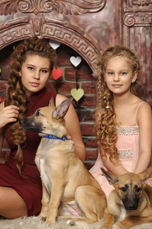 two sisters with a puppy photo