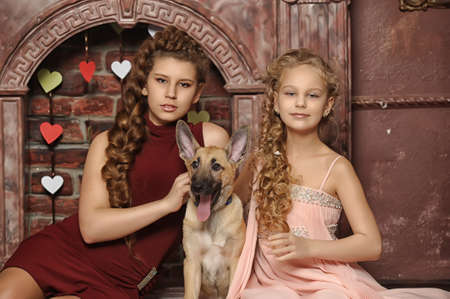 two sisters with a puppy Stock Photo - 17935848