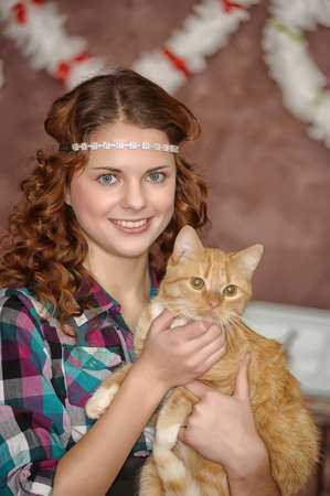 Beautiful teen girl with a cat in hands photo