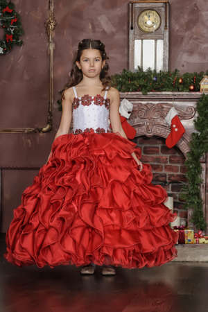 curtsy: A young girl in costume princess Stock Photo