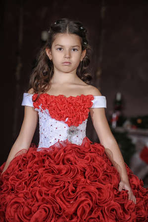 Girl in a smart red and white ball gown photo
