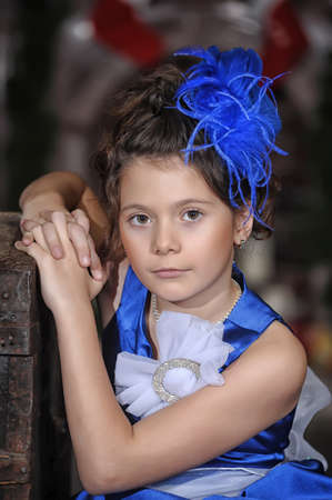 Girl in a smart blue dress Stock Photo