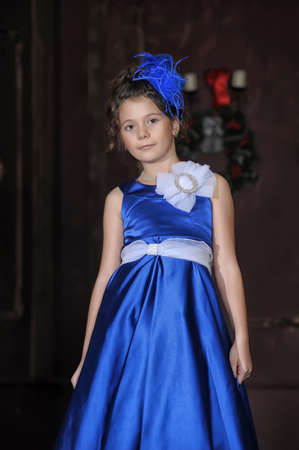 Girl in a smart blue dress photo