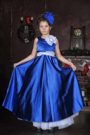 frock: Girl in a smart blue dress Stock Photo