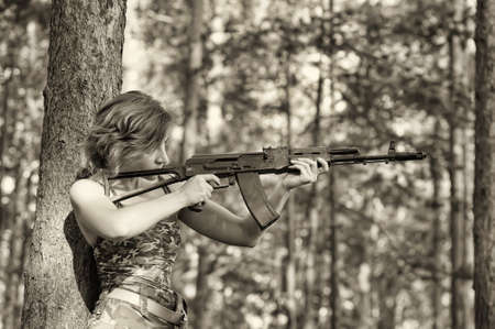 woman with a gun Stock Photo - 17988540