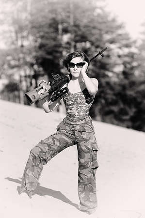 woman with a gun photo