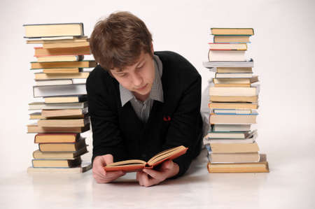 The student with a considerable quantity of books Stock Photo - 18160704