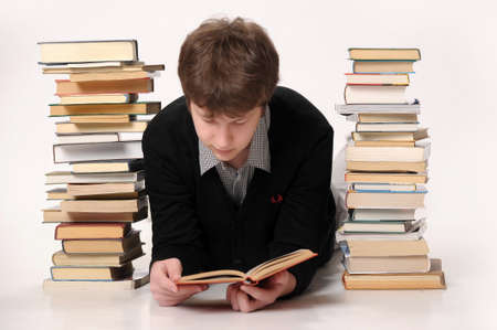 The student with a considerable quantity of books Stock Photo - 18160782