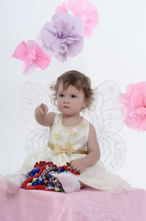 Little girl with butterfly s wings photo
