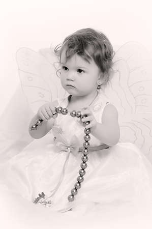 Little girl with butterfly s wings Stock Photo - 18296826