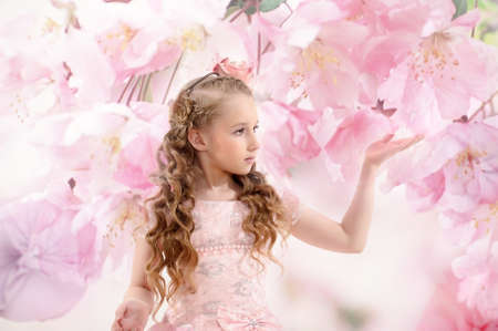 Beautiful fairy girl in a flowering garden photo