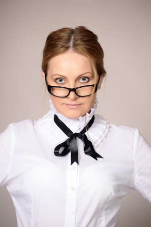 woman in a white blouse and glasses teacher photo
