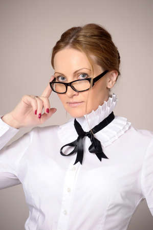 woman in a white blouse and glasses teacher Stock Photo - 21076572