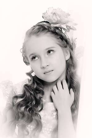 Retro style girl with a flower in the curls photo