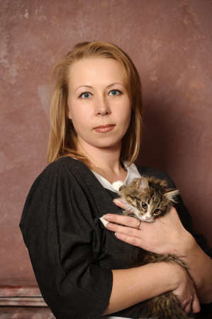 woman with a kitten Stock Photo - 18160726