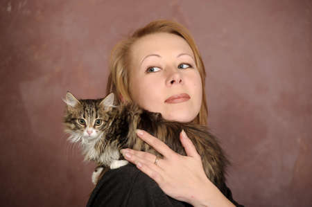 woman with a kitten Stock Photo - 18160729