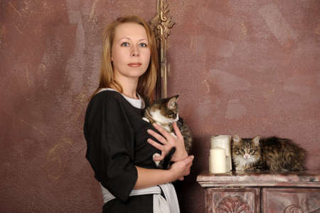 pillowy: woman with a kitten Stock Photo