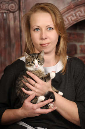 woman with a kitten Stock Photo - 18160720
