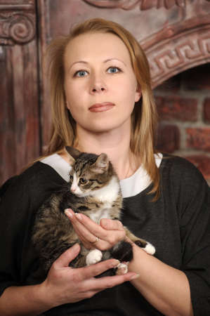 curled lip: woman with a kitten Stock Photo