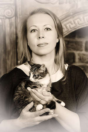 woman with a kitten Stock Photo - 18160246