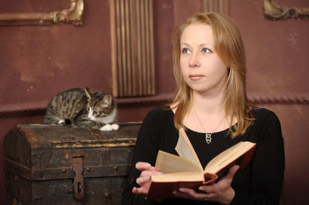 woman with a book and a kitten photo