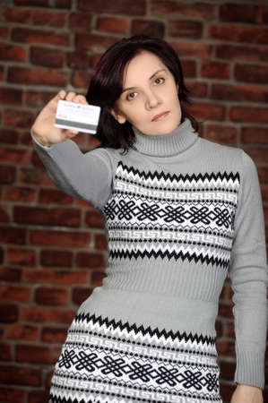 a young woman shows bank credit cards are photo