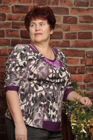 short haircut: portrait of an elderly woman with a short haircut