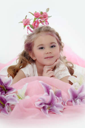 young princess wearing a crown of flowers photo