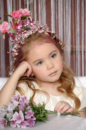 little princess with flower crown on head photo