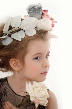 little girl with flowers on her head and a white rose in her hand Stock Photo - 19283227