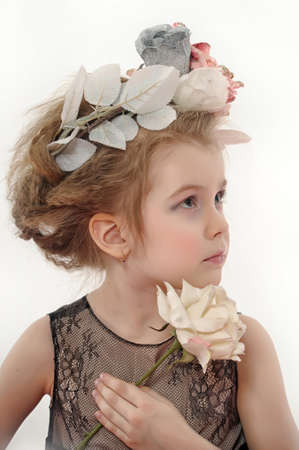 little girl with flowers on her head and a white rose in her hand Stock Photo - 19283222