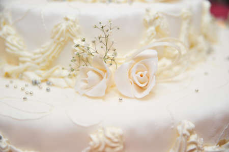 white wedding cake fragment photo