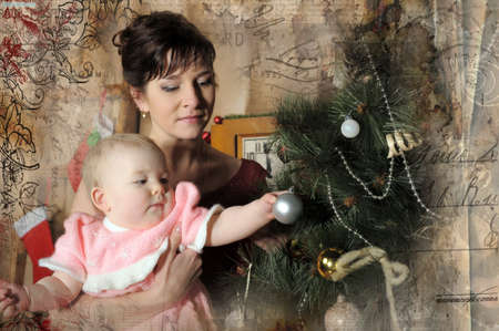 mom with a little girl in the arms of a Christmas tree Stock Photo - 18229487